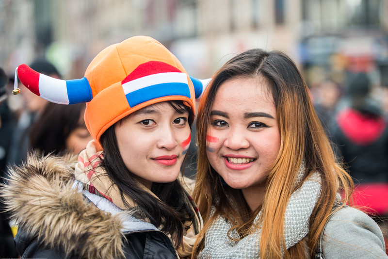 Two girls pose for a picture as they party and enjoy on the streets on King's Day (formerly Queen's Day) celebrations in Amsterdam, Netherlands, Europe.