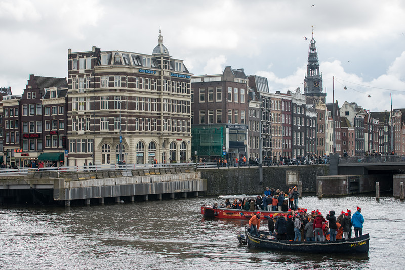 On King's Day (formerly Queen's Day) festivities in Amsterdam, Netherlands, Europe. Celebrations everywhere including on the water.