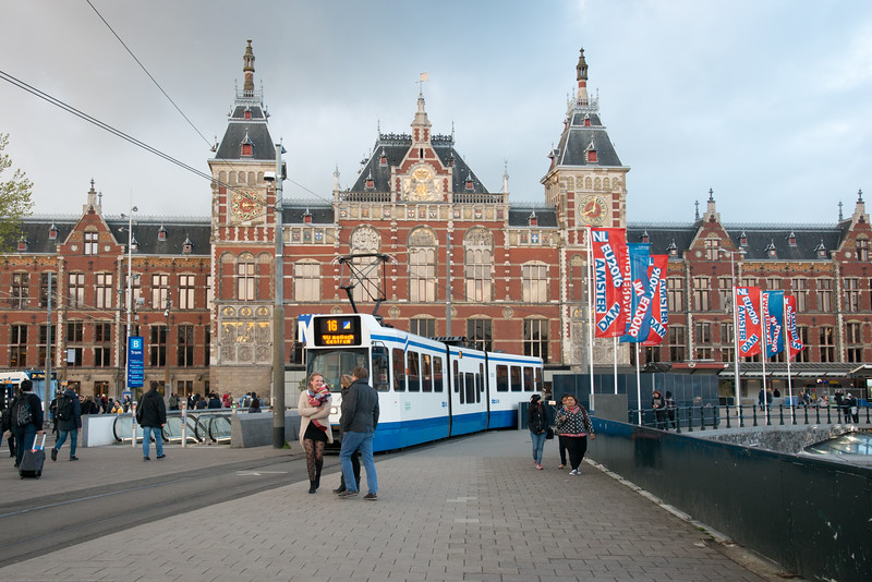 Tram in front of Amsterdam, Centraal Station. Amsterdam, Netherlands, Europe.