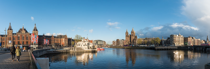 "Panoramic view of Amsterdam across the Amstel river which runs through the city of Amsterdam. The river's name is derived from Aeme-stelle, old Dutch for ""water-area"", namely, an area abounding with water. Amsterdam, the Netherlands, Europe."