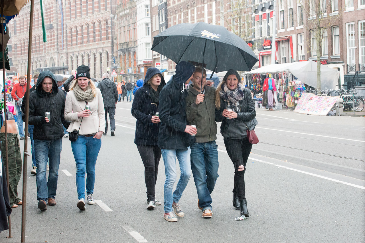 Rain or sunshine does not dampen the spirits. On King's Day (formerly Queen's Day) festivities in Amsterdam, Netherlands, Europe. Throughout the city, professional street performers vie for attention. There are pick-up bands, aspiring opera singers, teenage rappers and street discos. Rio-style drum bands have been very popular the past few years.  Huge concerts organized at various locations in the city, such as Dam square, Rembrandtplein and Museumplein but the city is a mess.