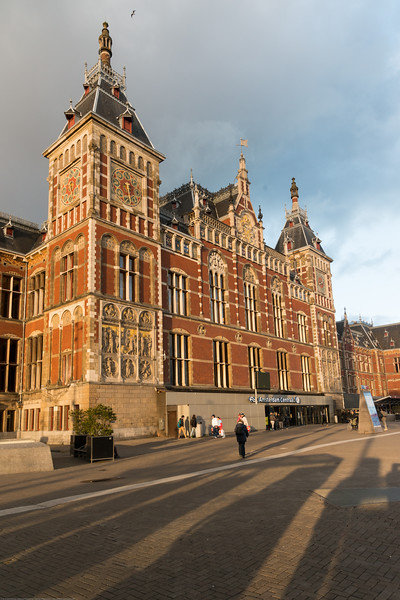 Amsterdam Centraal. It was designed by Pierre Cuypers, who is also known for his design of the Rijksmuseum in Amsterdam. While Cuypers was the principal architect, it is believed that he focused mostly on the decoration of the station building and left the structural design to railway engineers. Amsterdam, the Netherlands, Europe.