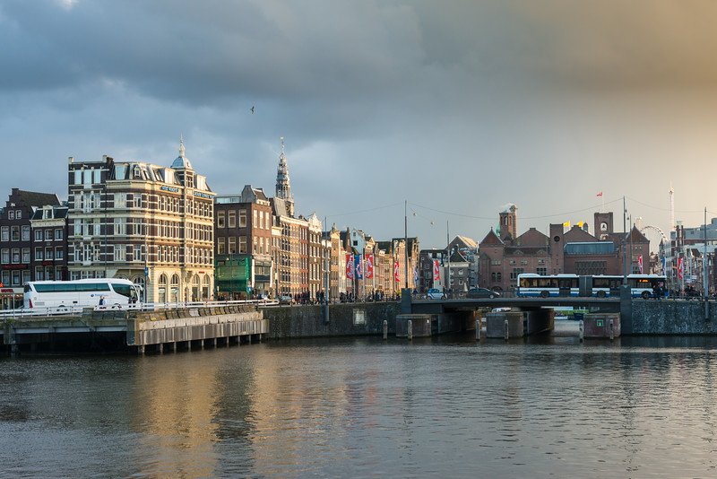 "City view across the Amstel which is a river in the Netherlands which runs through the city of Amsterdam. The river's name is derived from Aeme-stelle, old Dutch for ""water-area"", namely, an area abounding with water. Amsterdam, the Netherlands, Europe."