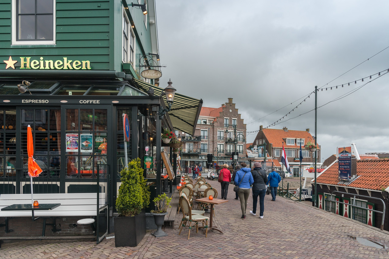 Waterfront shops and restaurants at Volendam, Netherlands near Amsterdam. 't Havengat bistro with the Heineken sign in Waterland, located right at the Volendam Marina where you board the Volendam-Marken Express.