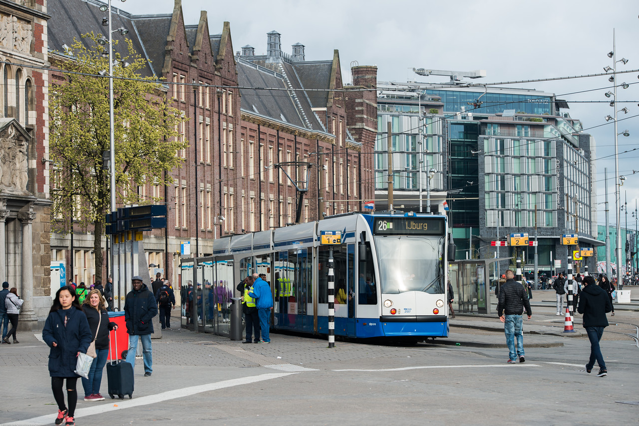 Tram service right outside the Amsterdam Central Railway station and at the VVV I amsterdam Visitor Centre Stationsplein. Amsterdam, the Netherlands, Europe.