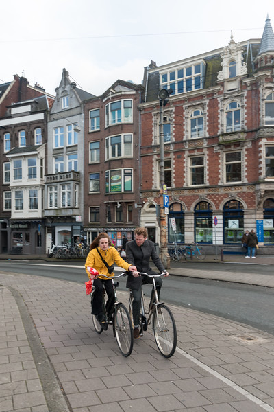 Cycling on the streets in Amsterdam, Netherlands, Europe.