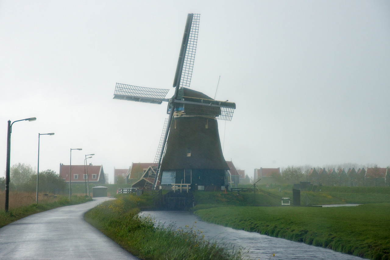 Windmills in the rains seen on the way to Volendam, Netherlands enroute to Amsterdam.