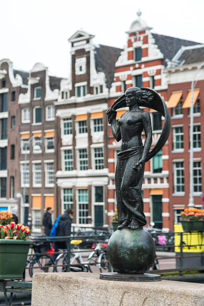 Statue of Lady Fortune, Vrouwe Fortuna, Amsterdam. The statue is made by the sculptor Hildo Krop, Amsterdam, Netherlands, Europe.