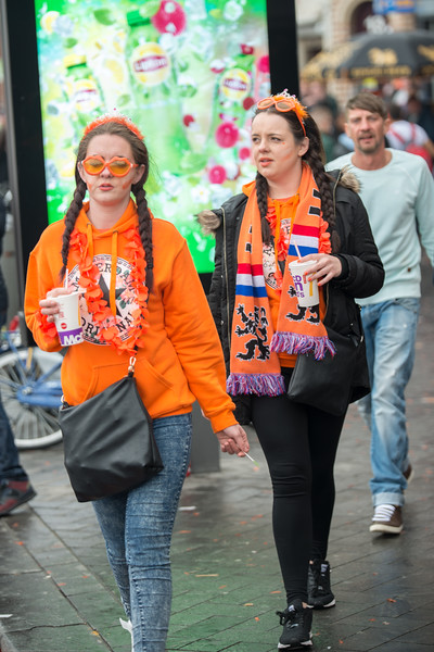 Party revelers in orange enjoying on the streets on King's Day (formerly Queen's Day) festivities in Amsterdam, Netherlands, Europe.