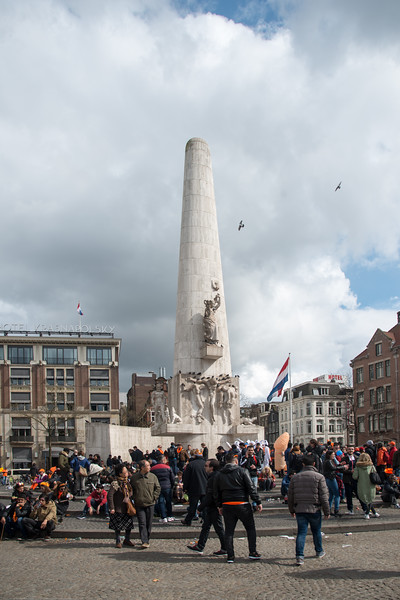 National Monument (Nationaal Monument), is a white travertine monument with relief sculpting & the national site for the remembrance of WWII on King's Day (formerly Queen's Day) celebrations in Amsterdam.<br /> <br /> King's Day 2016 - Koningsdag 2016 is the Dutch national holiday held on Wednesday 27 April 2016. Following the abdication of Queen Beatrix in 2013. Many Amsterdam residents set up shop directly outside their own houses  and come to the open spaces.