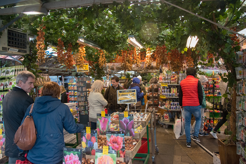 Flower shopping at Stins Flower Market, Singel 630, 1017 AZ, Amsterdam, Netherlands, Europe. This is the only floating flower market in the world, and one of the most fragrant places of interest of Amsterdam - in all seasons. The flower stalls stand on the houseboats. You will find there all sorts of tulips, narcissus and other bulbs and flowers. The bulbs are ready for export, so you can enjoy them at home too.