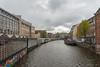 Canal near Stins Flower Market and Munttoren. Amsterdam, Netherlands, Europe.