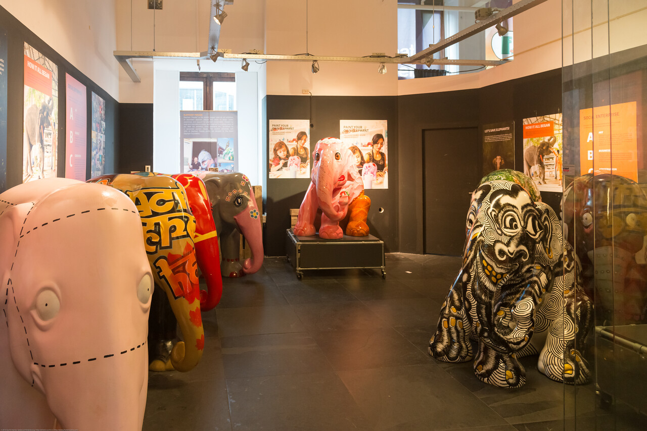 Elephant Parade® at Shopping Centre Magna Plaza in Amsterdam, Netherland. Elephant Parade® is a social enterprise and runs the world's largest art exhibition of decorated elephant statues. Created by artists and celebrities, each statue Elephant Parade is a unique art piece. The life-size baby elephant statues are exhibited in international cities and raise awareness for the need of elephant conservation.<br /> <br /> Limited edition, handcrafted replicas and a select range of products are created from the exhibition elephants. 20% or Elephant Parade just Profits are Donated to elephant welfare and conservation projects.