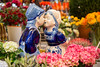 Kissing boy and girl porcelain statue at the flower shop at Stins Flower Market, Singel, Amsterdam, Netherlands, Europe. This is the only floating flower market in the world, and one of the most fragrant places.