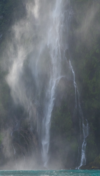 Misty waterfall at Milford Sound, New Zealand
