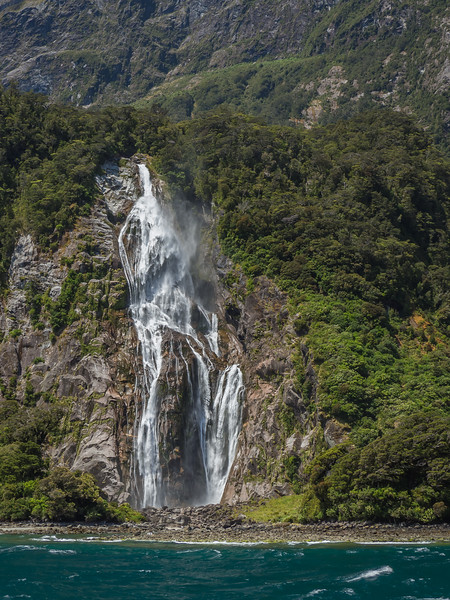 A torrent of water falls into Milford Sound in New Zealand