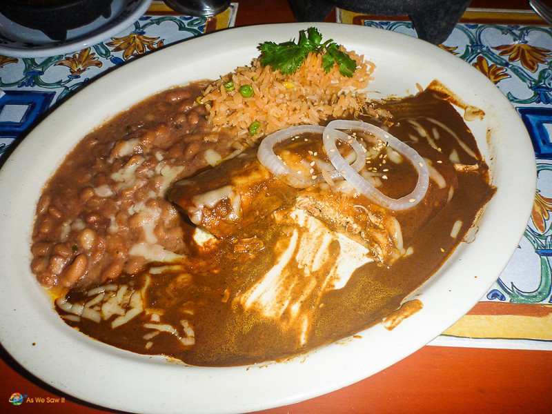 these beef enchiladas with typical rice and beans are a perfect choice of foods in mexico