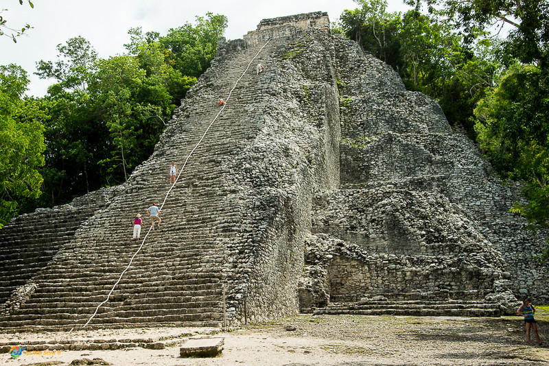 People climbing a pyramid in Coba, Mexico. This is one of the top attractions in Cozumel.