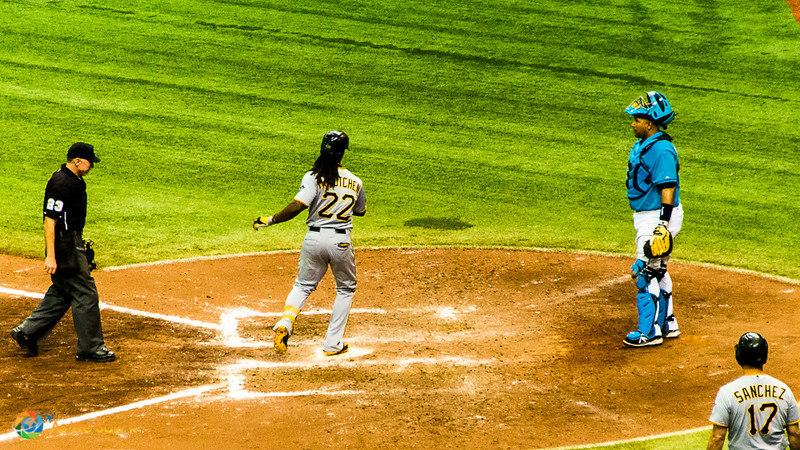 Andrew McCutchen arrives at home base after hitting a home run