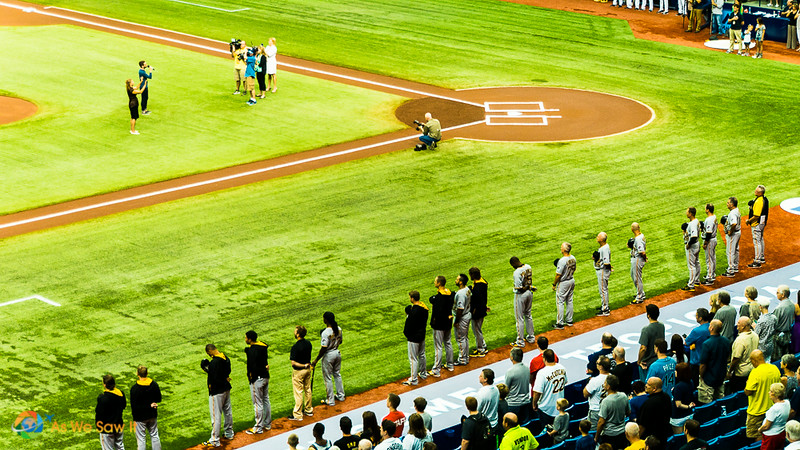 Players lined up along the field for the opening ceremony