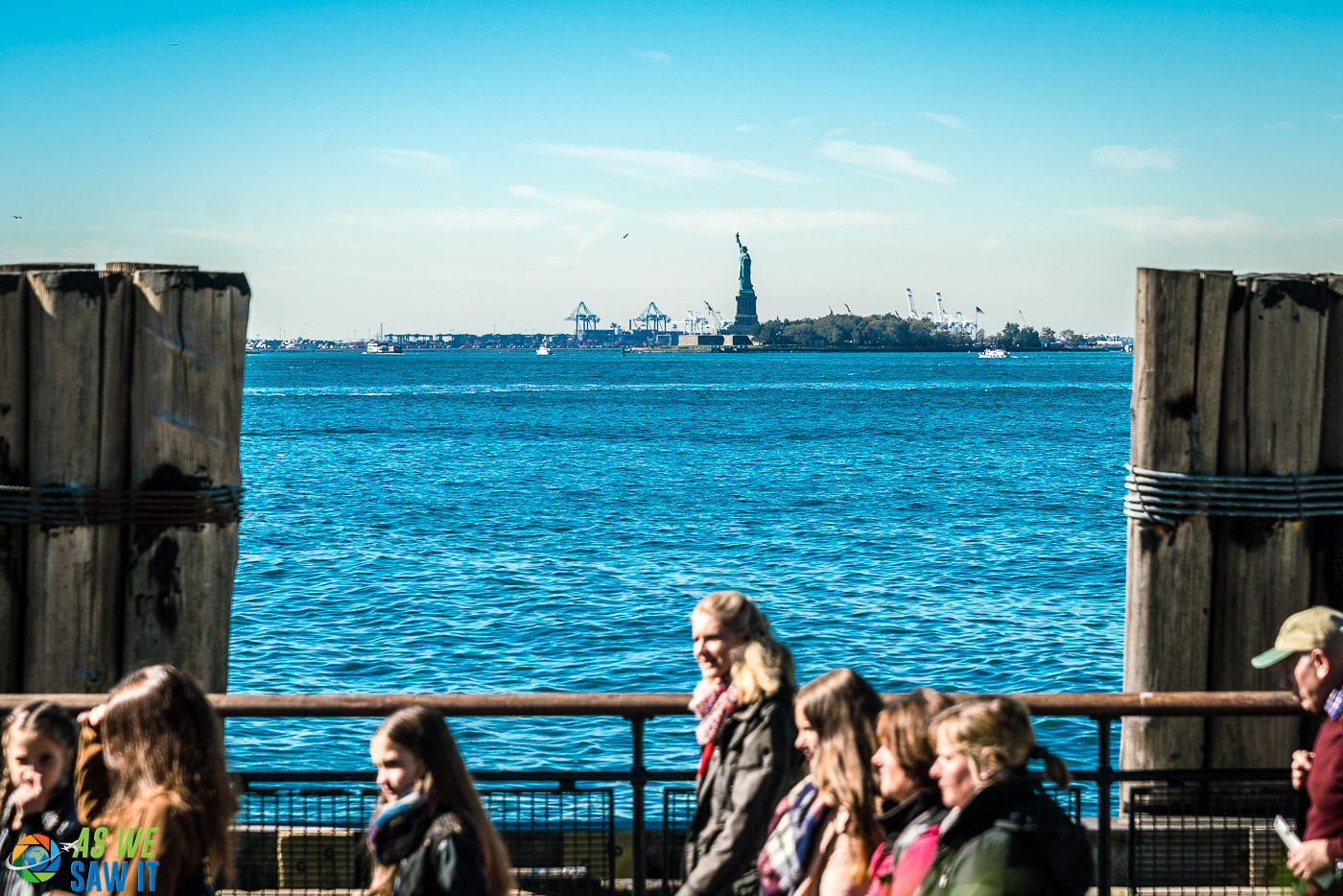 View of Lady Liberty from Battery Park. People in foreground have just exited the Liberty Island ferry.