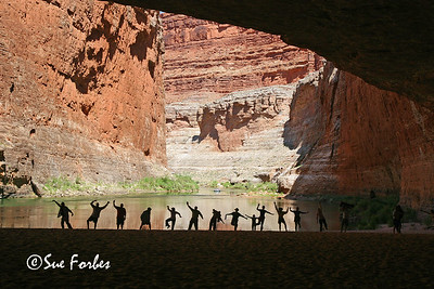 Silhouettes People silhouetted in Redwall Cavern at mile 33 of the Colorado River through the Grand Canyon