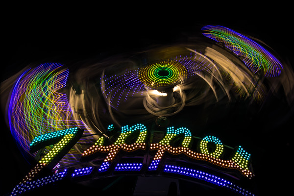 """I love the way carnival rides become abstract art at night. This is one of my favorite rides to shoot because it looks so different depending on the length of your exposure. You can see more images from this particular day at the fair at <a href=""""https://explorationvacation.net/2015/08/on-the-midway-the-minnesota-state-fair/"""">https://explorationvacation.net/2015/08/on-the-midway-the-minnesota-state-fair/</a>"""
