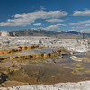 Mammoth Hot Springs is one of the largest thermal features in Yellowstone National Park. The limestone beneath the hot springs is dissolved in the hot water and brought to the surface where it creates white terraces. Heat-loving microorganisms add color to the steaming water that flows over the terraces or collects in pools within them. The site consists of Upper and Lower terraces, and activity within any are can change from day to day. These photos are from several locations along the Upper Terrace. Yellowstone is located in the Rocky Mountains of the western USA.