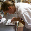 The pastry chef prepares a plate