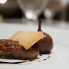 Foies gras with poached black mission fig braised savoy cabbage balsamic glaze, portuguese sweet bread crouton.