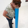 Lynn is checking out the Painter Painter exhibit rather closely!