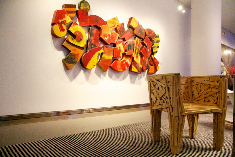 Wooden chair and art.