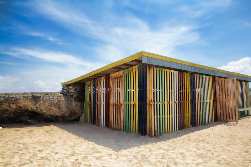 An abandoned beach building makes a nice rainbow