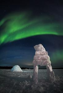 Igloo and Inukshuk under Aurora Borealis, Yellownife