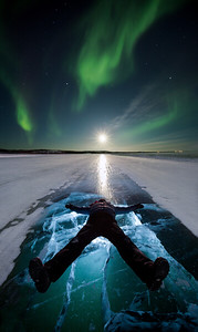 Aurora and full moon over iceroad, Yellowknife