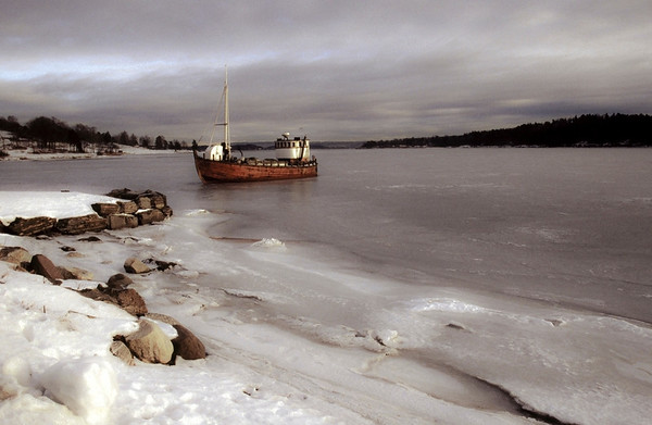 Boat stuck in the ice in the Oslo Fjord.  Oslo, Norway, 2000.