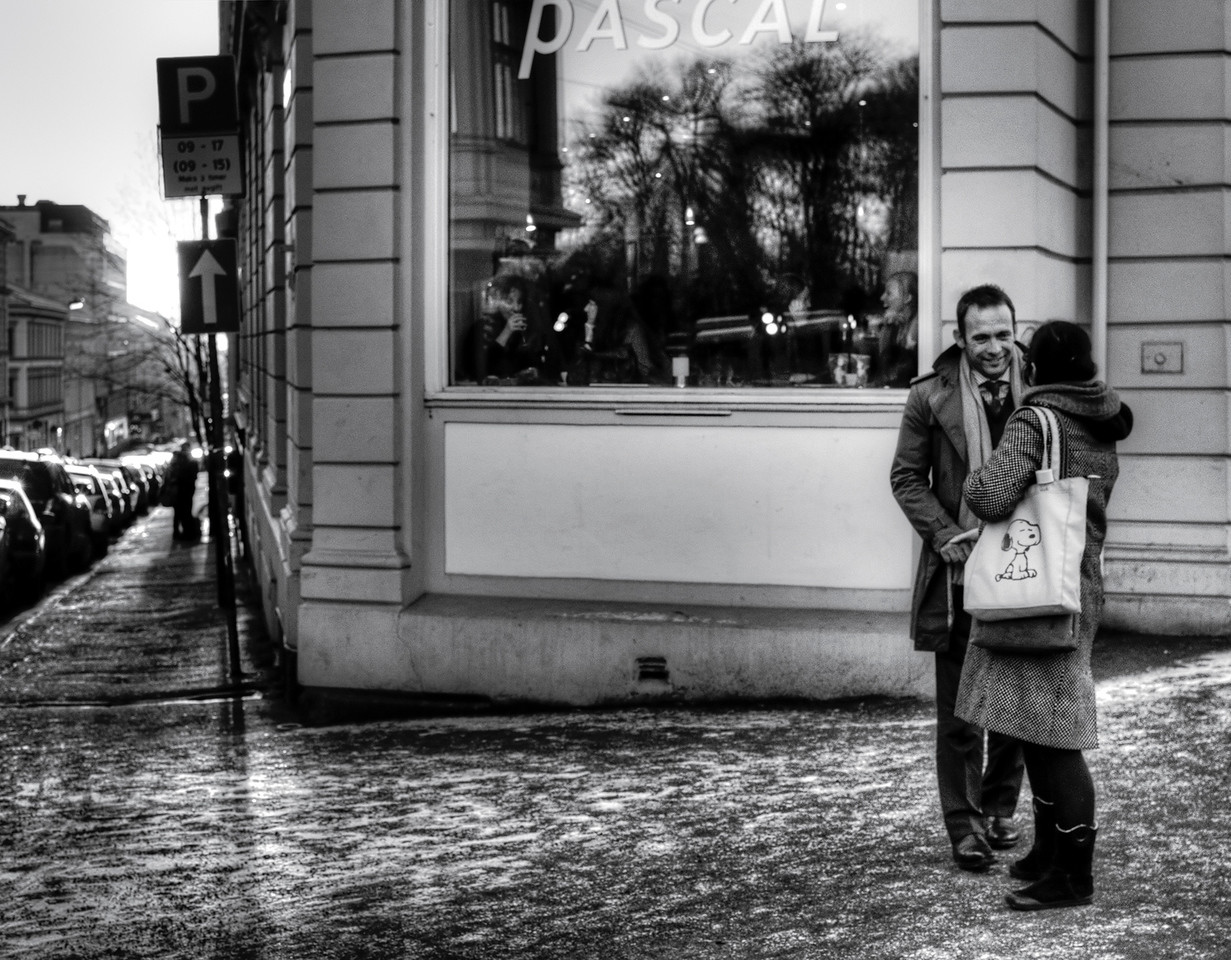 Couple outside a popular French bakery.<br /> <br /> Oslo, Norway, 2012.