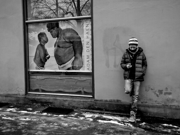 Young man waiting for the bus.  Oslo, Norway, 2012.