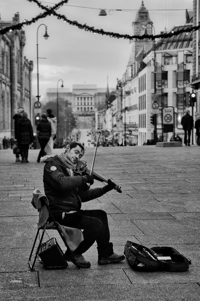 Street musician in Karl Johans gate.<br /> <br /> Oslo, Norway, 2012.
