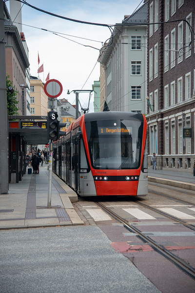 Tramp and public bus in the streets of Bergen, Norway, Europe.