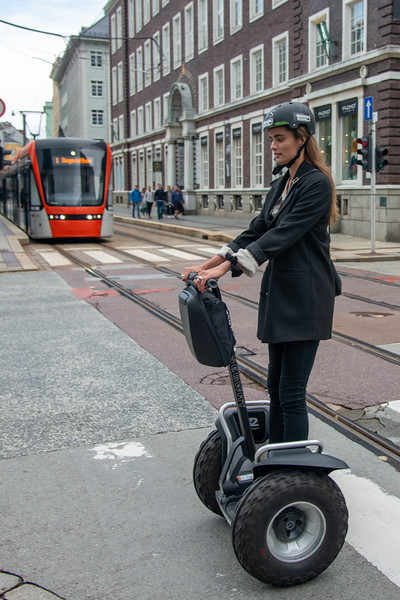 Lady tourists getting around Bergen, Norway on Segway which is and  incredible personal transportation vehicles making getting around easier.