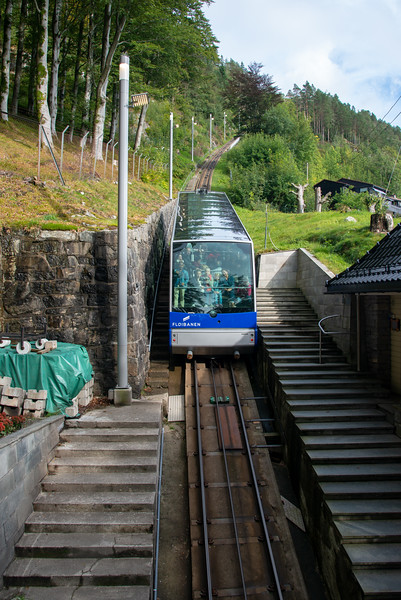 Fløibanen is a funicular which runs from the city centre to Mount Fløyen and Ulriksbanen is an aerial tramway which runs to Mount Ulriken. Bergens Tidende. Bergen, Norway.