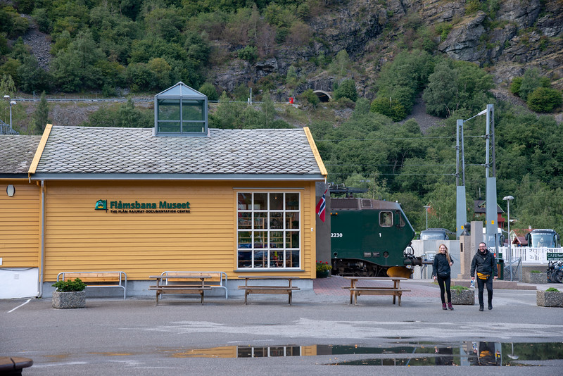 Flam Railway Museum (<br /> Flåmsbana Museet). Flåm is a village in Flåmsdalen, at the inner end of the Aurlandsfjorden—a branch of Sognefjorden. The village is located in the municipality of Aurland in Sogn og Fjordane county, Norway.