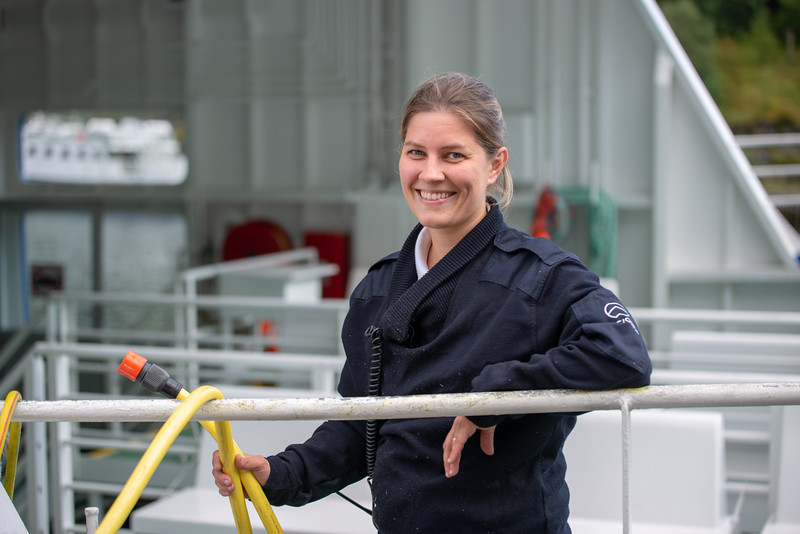 Staff working onboard a ship docked in Flam. Flåm is a village in Flåmsdalen, at the inner end of the Aurlandsfjorden, Aurland, in Sogn og Fjordane county, Norway.