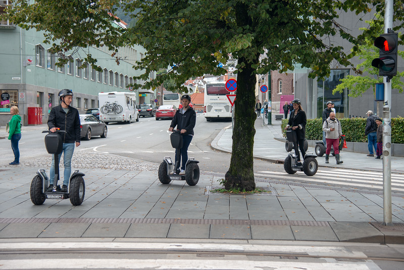 Tourists getting around Bergen, Norway on Segway which is and  incredible personal transportation vehicles making getting around easier.