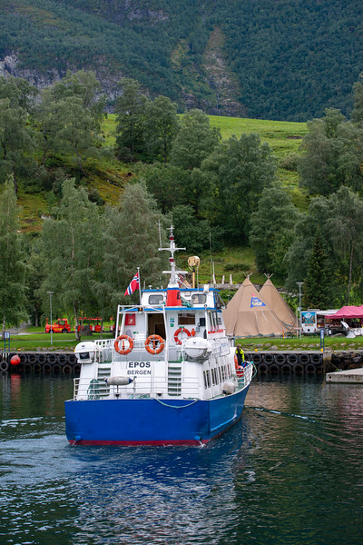 Many tourists arrive into Flam on ship or cruise. Flåm is a village in Flåmsdalen, at the inner end of the Aurlandsfjorden, Aurland, in Sogn og Fjordane county, Norway.