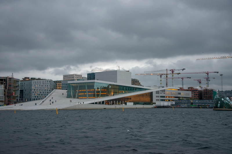 Oslo Opera House view across the harbour from Revierkaia, waterfront, Oslo, Norway.<br /> Oslo is a popular cruise destination with over hundred cruise calls from over 45 cruise ships.