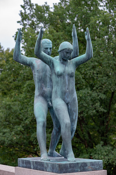 Vigeland installation - naked couple – the sculptures in Frogner Park, Oslo, Norway. The sculpture area in Frogner Park covers 80 acres (320,000 m2) and features 212 bronze and granite sculptures, all designed by Gustav Vigeland. Most of the statues depict people engaging in various typically human pursuits, such as running, wrestling, dancing, hugging, holding hands and so on. However, Vigeland occasionally included some statues that are more abstract, including one statue, which shows an adult male, fighting off a horde of babies.
