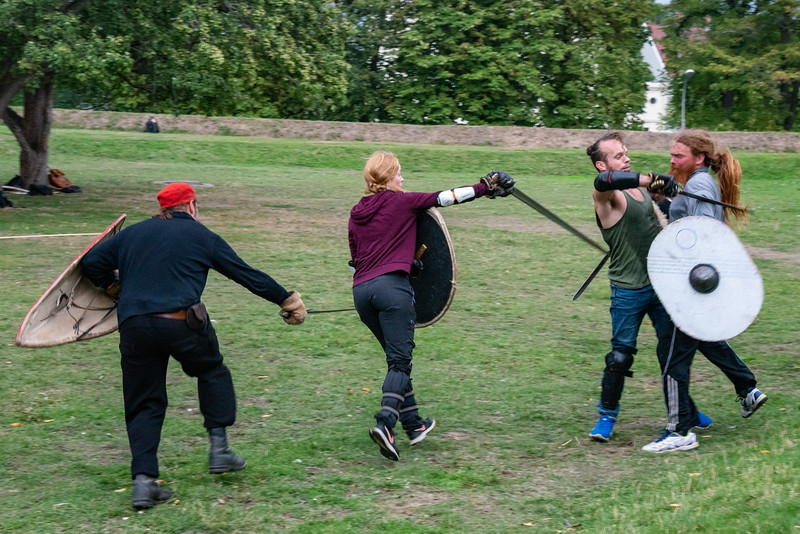 Enacting old time Viking warrior battles at Akershus Fortress (Akershus Festning), Oslo, Norway, Scandinavia.<br /> Originally construct in the 13th century, this fort contains 2 military museums & hosts events.