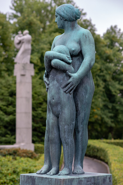 Vigeland installation – naked mother & daughter - the sculptures in Frogner Park, Oslo, Norway. The sculpture area in Frogner Park covers 80 acres (320,000 m2) and features 212 bronze and granite sculptures, all designed by Gustav Vigeland. Most of the statues depict people engaging in various typically human pursuits, such as running, wrestling, dancing, hugging, holding hands and so on. However, Vigeland occasionally included some statues that are more abstract, including one statue, which shows an adult male, fighting off a horde of babies.